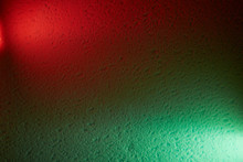 Red And Green Lanterns On A Textural Background Shine Meeting Each Other