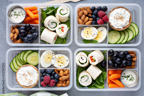 Photo  Healthy lunch or snack to go with tortilla wraps, eggs, cottage cheese, fruits a