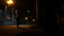 Woman Walks Down Dark Secluded...