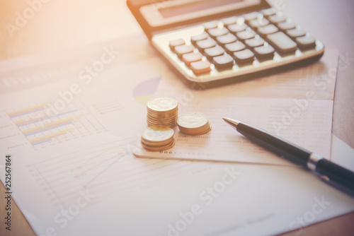 Fototapeta Double exposure of city and pen, calculator , money , graph for finance and business concept obraz