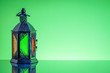 Leinwanddruck Bild - Ramadan lantern or Arabic decoration lamp on green background. Selective focus