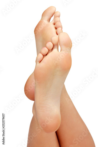 Poster Pedicure Closeup shot of female feet isolated on white background.