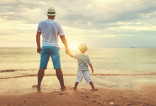 Happy Fathers Day. Family Dad And Child Son At Beach.