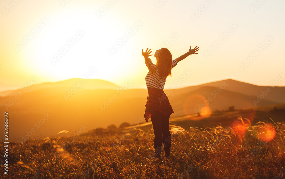 Fototapety, obrazy: Happy woman jumping and enjoying life  at sunset in mountains.