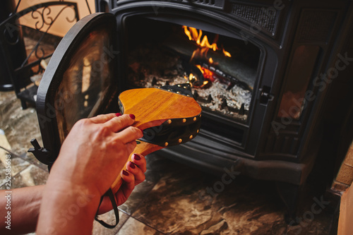 Fireplace bellows in the female palms of the hands. Wallpaper Mural