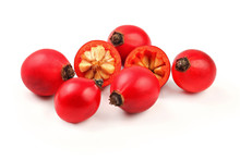 Rosehips ( Rosa Canina Fruits ) , One Cut In Half, Isolated On White Background.