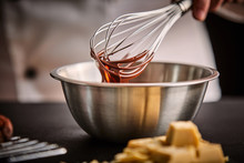 Chef Preparing Melted Chocolate In A Mixing Bowl