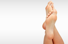 Beautiful Woman's Bare Feet Ag...