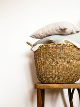 Wicker Basket With Gray Cushio...