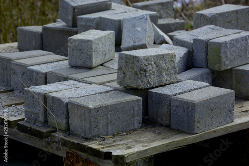 forgotten rough cement blocks as a sign of transience in a