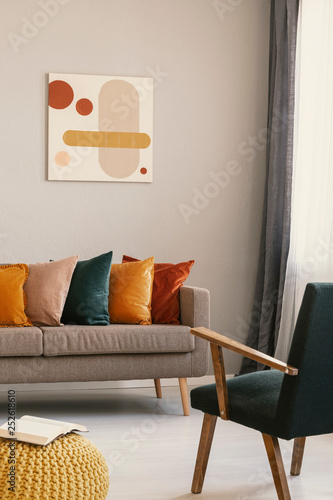 Abstract painting on grey wall of retro living room interior ...