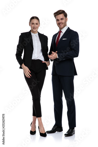 Photo sur Toile Kiev couple in business suits standing with hands together