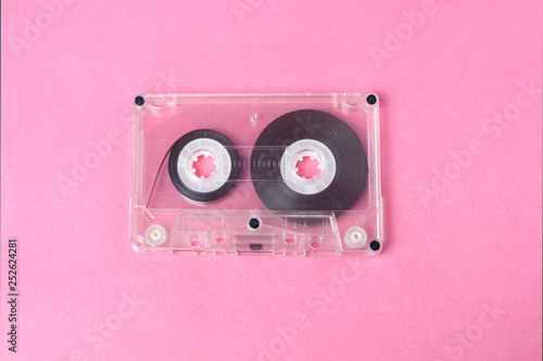 Audio retro vintage cassette tape 80s style on pink background - 252624281