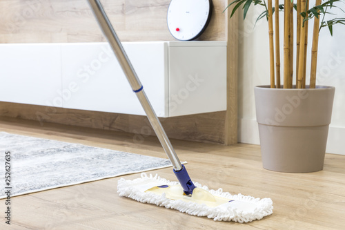 Fotomural  Wooden floor with white mop, cleaning service concept