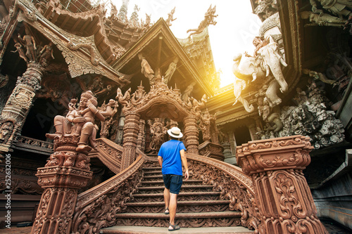 A man tourist is sightseeing inside the Ancient wooden Sanctuary of Truth in Pattaya, Thailand Tapéta, Fotótapéta