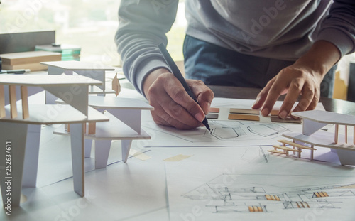 architect design working drawing sketch plans blueprints and making architectural construction model in architect studio - 252637614
