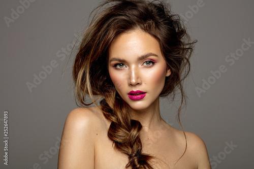 Obraz Beauty portrait of female model with messy hair and braid - fototapety do salonu