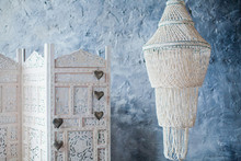 White Folding Screen And Chandelier Of Shells