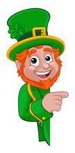 A Leprechaun St Patricks Day Irish Cartoon Character Peeking Around A Sign Or Banner And Pointing
