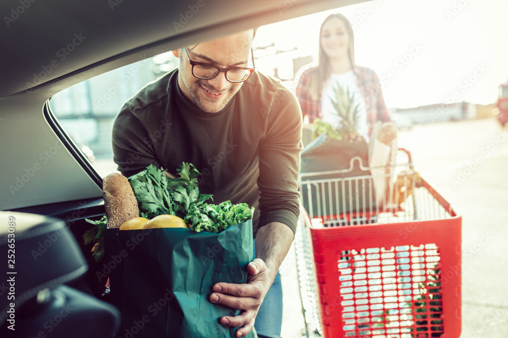 Fototapety, obrazy: Husband and his wife after buying food in grocery store or supermarket.