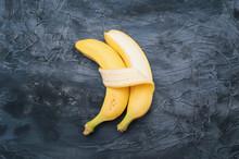 Two Bananas Isolated On Dark B...