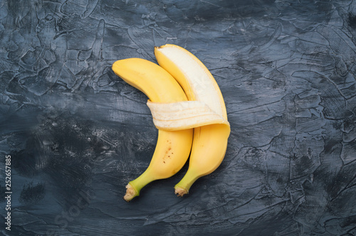 Fototapeta Two bananas isolated on dark background obraz