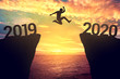 canvas print picture - Businessman jump between 2019 and 2020 years.