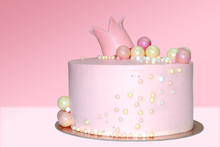 Pink Cake For A Girl With A Decoration In The Form Of A Crown And Balls On An Isolated Background