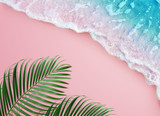 Fototapeta Bathroom - tropical palm leaf and soft blue wave on pink background