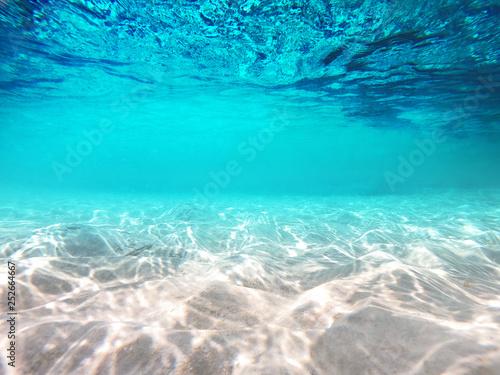 Underwater scene with sun ray background Fototapeta