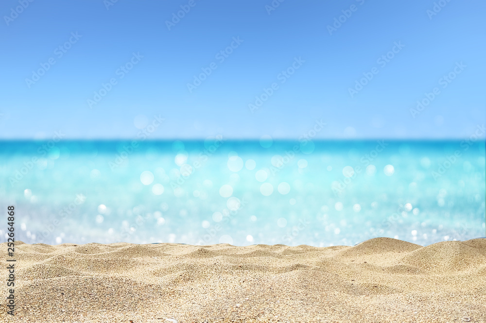 Fototapeta beautiful sandy beach with blur ocean background summer concept