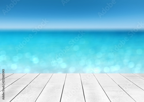 Poster Turquoise wooden table top with blur ocean background summer concept