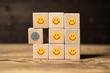 canvas print picture - Viele Würfel mit lächelnden Smileys und einer der unzufrieden ist