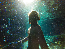 Man Underwater With Sunlight S...