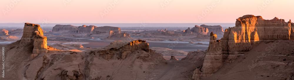 Fototapeta Panoramic view of sandy mountains in Kaluts desert, part of Dasht-e Lut desert during sunrise, Iran