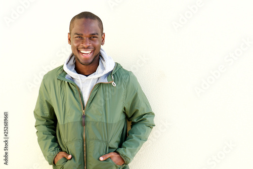 Fotografie, Obraz  happy african american man posing in windbreaker by wall