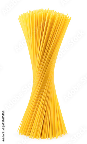 Raw spaghetti stands on a white, isolated. Pasta Wall mural