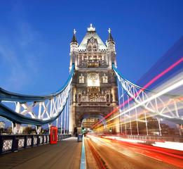 Fototapeta na wymiar Tower Bridge at night with bus light trails.
