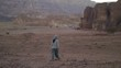 young woman walking in desert in the evening after sunset. Timna Park Israel