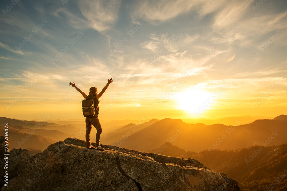 Fototapety, obrazy: Hiker meets the sunset on the Moro rock in Sequoia national park, California, USA.