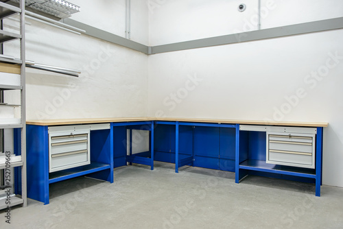 Obraz Interior of a small storage room with shelf and workbench - fototapety do salonu