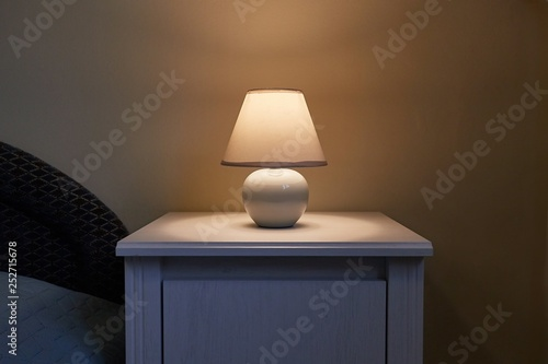 Photo  Lamp on a nightstand