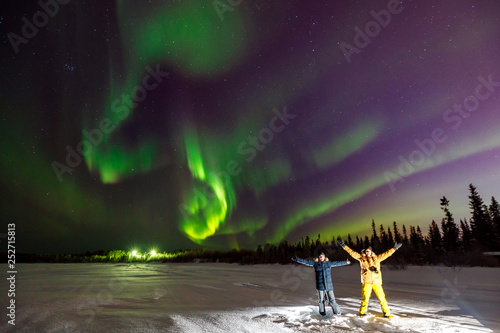 Foto auf Gartenposter Aubergine lila Multicolored green Violet vibrant Aurora Borealis Polaris, Northern Lights in night sky. Concept travel people