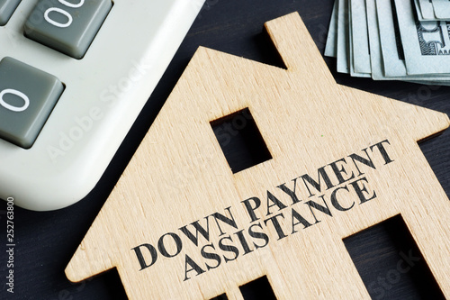 Fototapeta Down payment assistance written on a model of home. obraz