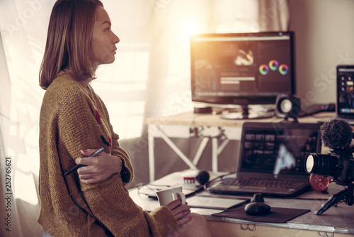 Cuadros en Lienzo  Editor video woman working with footage video on laptop and computer pc in the h