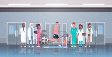 Doctors Group Checking Male Patient Running On Treadmill With Electrodes Attached To Body Sports Cardiology Science Concept EKG Laboratory Interior Horizontal Flat Full Length