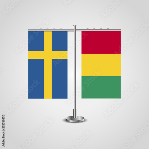 Fotografía  Table stand with flags of Sweden and Guinea