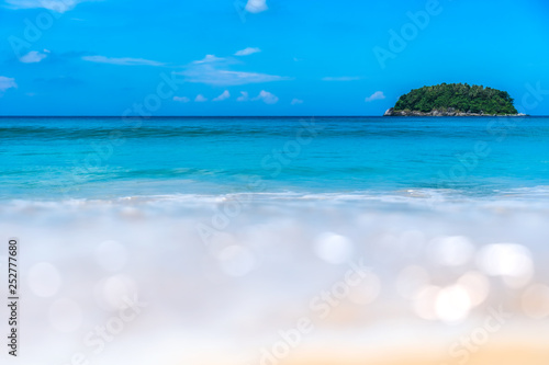 Aluminium Prints Blue Blur tropical beach with bokeh sun light wave abstract background.