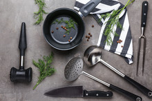 Set Of Kitchenware On Grey Bac...
