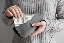 Woman Holding Wallet With Mone...